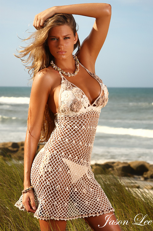 This Hand Made Crochet Summer Dress has a flowered partially transparent bust with a sexy netted skirt and sweet pearl.